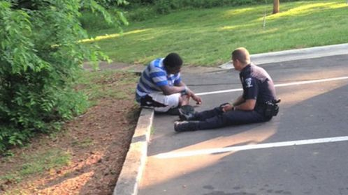 Police Officer Consoling Teen